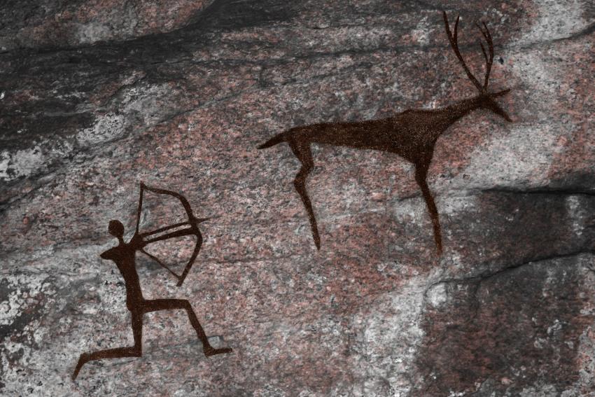 Höhlenmalerei mit Jäger und Hirsch